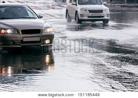 Cars Driving On Water Puddles After Downpour
