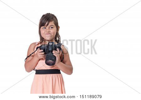 Sneers face long hair little girl is holding SLR camera. All is isolated on the white background. All potential trademarks are removed.