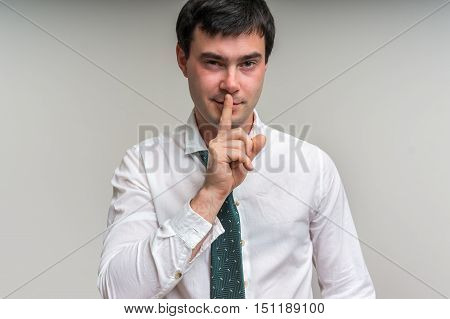 Attractive Man With Finger On Lips Making Silence Gesture