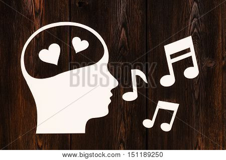 Paper head with hearts inside, singing. Love concept. Abstract conceptual image