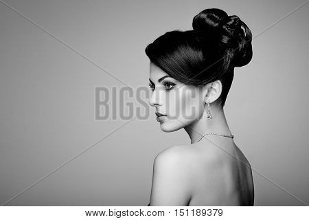 Fashion portrait of young beautiful woman with jewelry. Brunette girl. Perfect make-up. Beauty style woman with diamond accessories. Black and White
