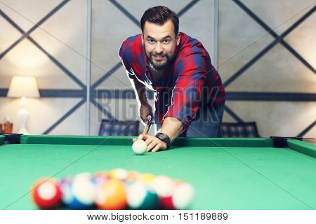 Picture of young man playing billards