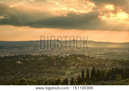 Florence or Firenze aerial foggy cityscape. Panorama view from Fiesole hill. Palazzo Vecchio and Duomo Cathedral. Tuscany Italy