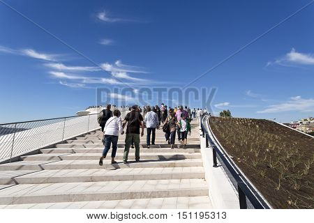 LISBON, PORTUGAL - October 5, 2016: People using the external stairway to access the belvedere on top of the MAAT (Museum of Art Architecture and Technology) building in Lisbon Portugal