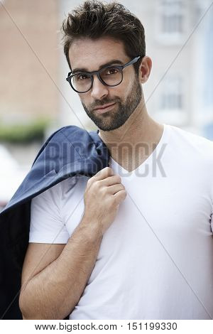 Man with beard and spectacles portrait - in town