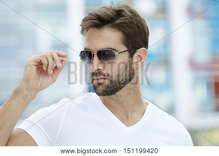 Cool guy in shades with beard in town