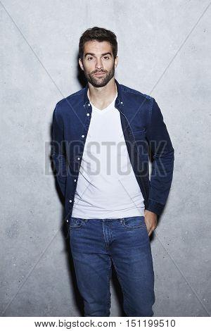 Cool guy in blue open shirt portrait