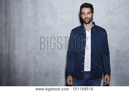 Content man in blue open shirt portrait