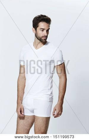 Guy in white shorts and t-shirt - grey background