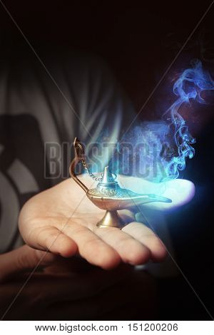 Aladdin's magical lamp, wishes coming true concept, genie in the arabic golden lamp
