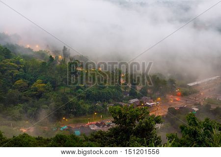 Early morning scenery of beautiful scenary valley of mountain at village color on the mist in the field