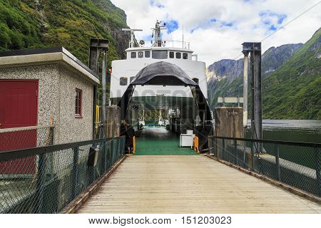 GUDVANGEN, NORWAY - JULY 3, 2016: Ferries is the primary mode of transportation for the fjords. This is ferry traveling on Naerifjord before being loaded on the town pier.