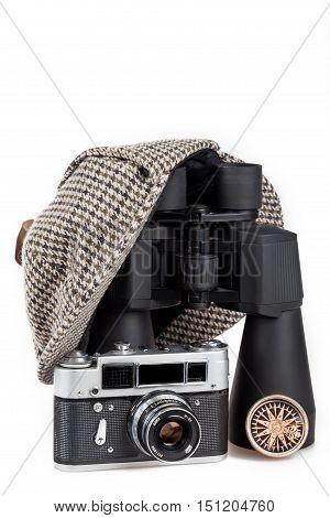 Black binoculars, Sherlock Holmes hat and Camera Isolated on White Background