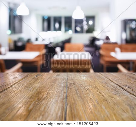 Table top Counter with Blurred table with seats Restaurant Shop interior background