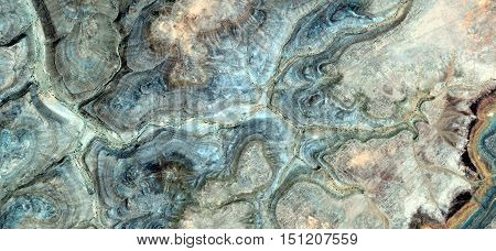 Allegory of fossil wandering star fleeing the storm is struck by lightning, photo of abstract landscapes of deserts of Africa from the air, collection of Abstract Naturalism Munimara