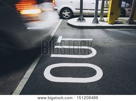 OUT Signage Parking Lot Gate Car moving Building outdoor