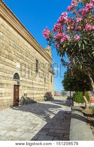 Flowers and Agios Nikolaos church in Zakynthos City, Greece