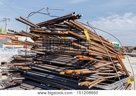 Steel bars stacked for construction classified by the bending shape at construction site.