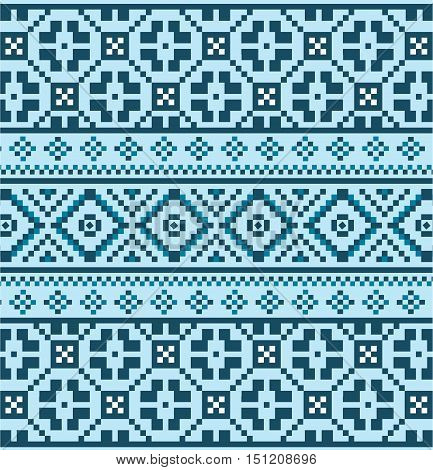 Winter seamless pixel pattern. Blue Pastiche Scandinavian embroidery ornament. Knitted Christmas ornament.