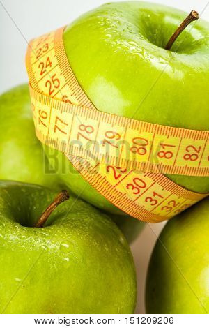 Green Apples From Which One Wrapped With Tape Measure Close-up