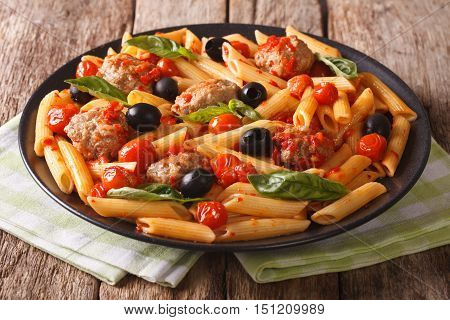Italian Cuisine: Pasta Penne With Meatballs, Olives And Tomatoes Close-up. Horizontal
