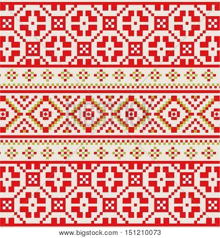 Winter seamless pixel pattern. Pastiche red Scandinavian embroidery ornament. Knitted Christmas ornament.