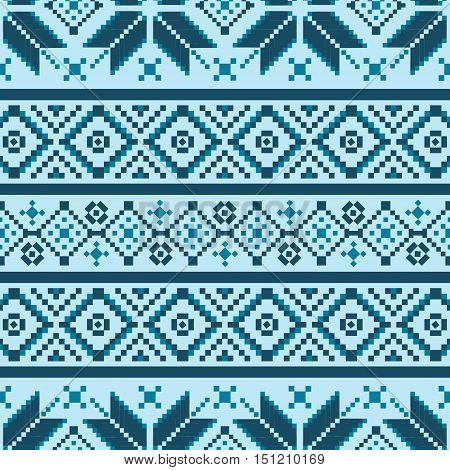 Winter seamless pixel pattern. Pastiche Scandinavian blue embroidery ornament. Knitted Christmas ornament.