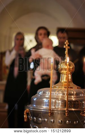 church candles fire on ceremony of Epiphany