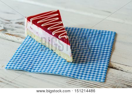 Slice of cake on napkin. Thin layer of jelly. Tasty dessert with currant mousse. Sweet dish in new cafeteria.