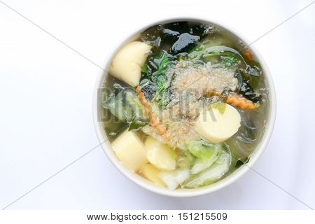 Thai Style Seaweed Soup With Bean Curd , Mixed Vegetable, Tofu  In White Bowl On White Background. V