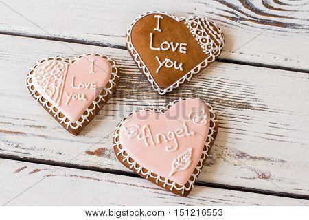 Three heart cookies. Glazed biscuits with inscription. Small gifts bring heart warmth. How to confess in love.