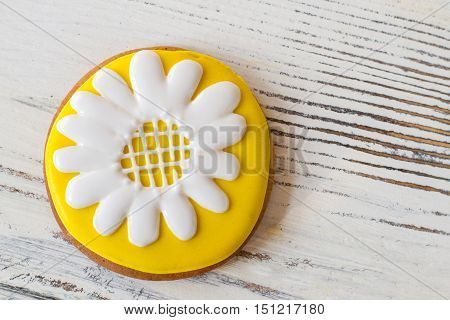 Biscuit with picture of flower. Bright frosted cookie. Inspiration and appetite. Crispy pastry with sugar glaze.