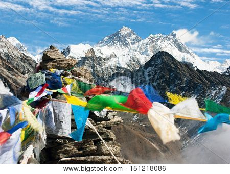view of Mount Everest Lhotse and Makalu with buddhist prayer flags from Gokyo Ri - Nepal