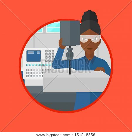 An african woman working on milling machine. Woman using milling machine at factory. Woman making a hole using a milling machine. Vector flat design illustration in the circle isolated on background.
