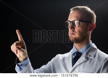 healthcare, people, profession and medicine concept - close up of male doctor in white coat touching something imaginary over black background