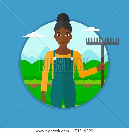 An african-american farmer standing with a rake at cabbage field. Young female farmer holding rake and working in cabbage field. Vector flat design illustration in the circle isolated on background.