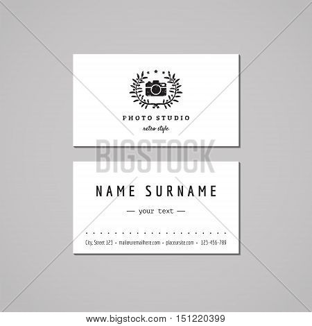 Photo studio business card design concept. Logo with photo camera and olive wreath. Vintage hipster and retro style. Black and white.