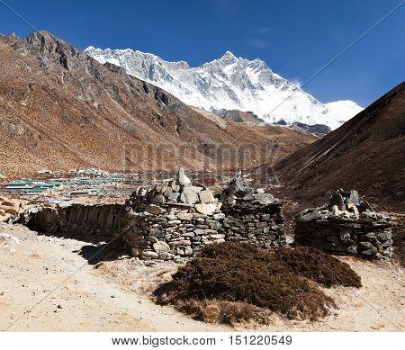 Prayer walls and Dingboche village with mount Lhotse way to Everest base camp Khumbu valley Solukhumbu Sagarmatha national park Nepalese himalayas