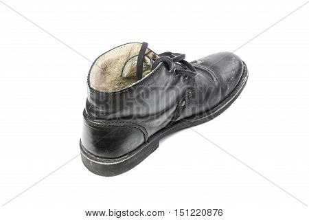 Winter men's shoes with a protruding salt isolated on white background