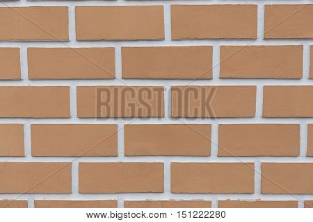 New brick wall of red brick brick background close-up