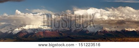 Evening panoramic view of Lenin Peak from Alay range - Kyrgyz Pamir Mountains - Kyrgyzstan and Tajikistan border- Central Asia