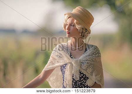 Vintage 1930S Fashion Woman With Hat In Rural Summer Landscape.