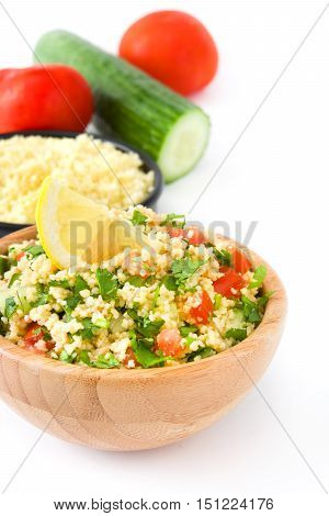 Tabbouleh salad with couscous and vegetables isolated on white background