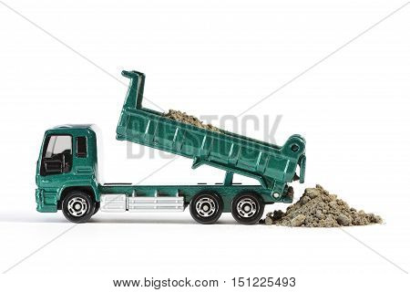 Green Dump Truck Unloading Soil to Ground