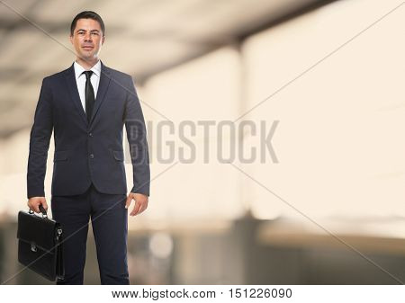 Businessman with briefcase on blurred office background. Lawyer and notary concept.