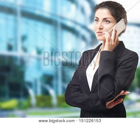 Businesswoman talking on phone on blurred building background. Lawyer and notary concept.