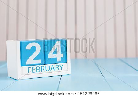 February 24th. Day 24 of month, calendar on wooden background. Winter concept. Empty space for text.