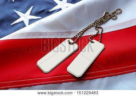 Soldier's tokens on American flag background