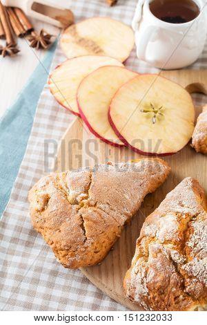 Apple scones for breakfast with apple cider glaze. Selective focus.
