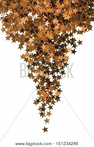 Golden star shaped glitter on white as a background